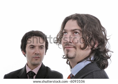 2 young businessmen portrait on white, the man of the right in first plan is with the focus - stock photo