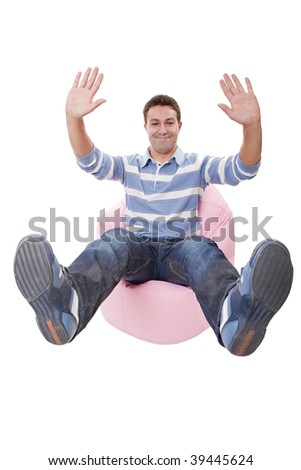 young casual man making stop with his hands and sit down with feet up