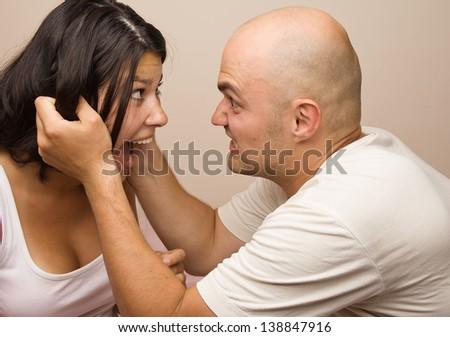 Young couple fighting.Studio shot - stock photo