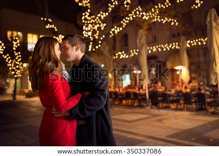 Young couple kissing on the street, relationships, love, people, birthday and holidays concept - stock photo