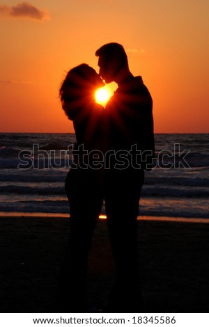 Young Couple pair on a sunset - stock photo