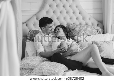 Beautiful Couple Lying Together On Bed Stock Photo