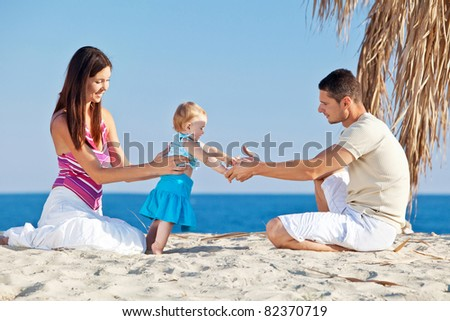 young family having fun on the beach - stock photo