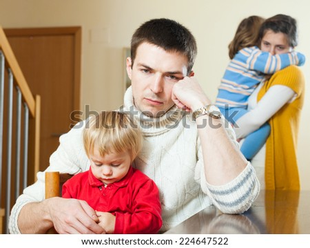 Young family with children having quarrel at home - stock photo