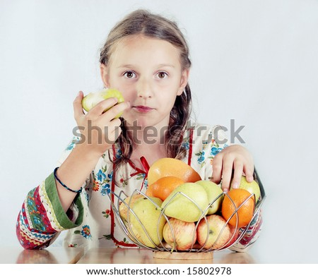 young girl eating pear