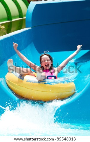 Young girl in the pool - stock photo