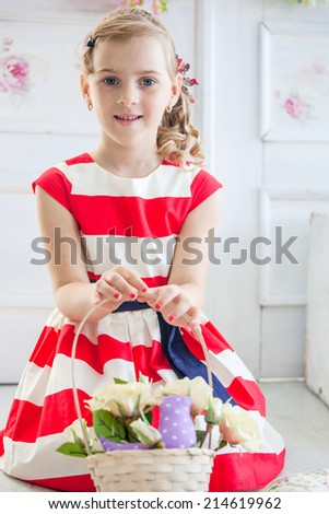 Young girl wearing a dress with basket in hands