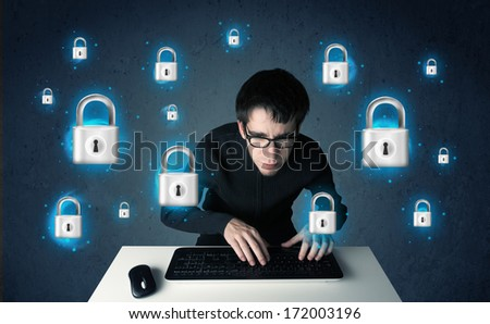 Young hacker with virtual lock symbols and icons on blue background - stock photo