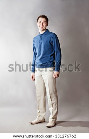 Young handsome man over gray background