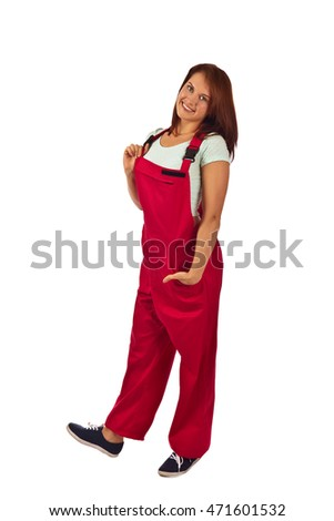 Young happy woman in red overalls  , isolated on a white background