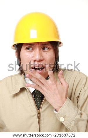 young Japanese construction worker shocked
