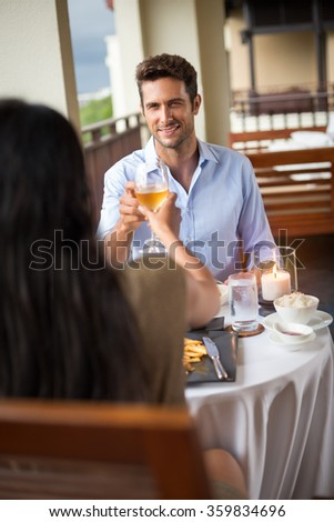 young loving couple toasting during dinner - stock photo