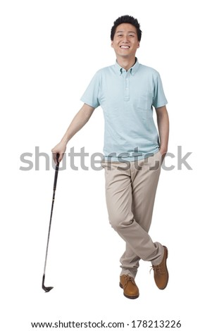 Young man holding golf swing and smiling  - stock photo