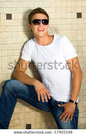 Young man in a white t-shirt - stock photo