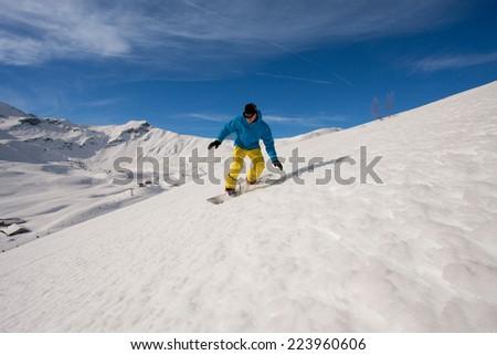 Young man snowboarding - stock photo