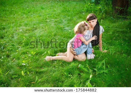 Young mother with child in nature.