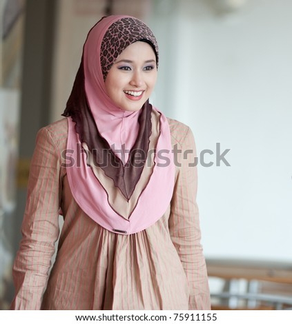 young muslim woman in head scarf - stock photo