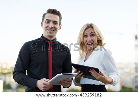 Young office workers with tablets on the background of the city - stock photo