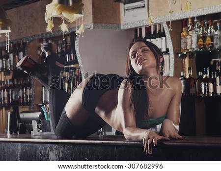 young pretty women dancing on bar night club - stock photo