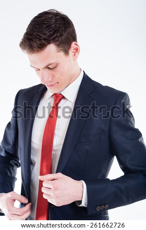 Young  smilling businessman in black suit and red tie - stock photo