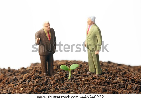 Young sprout with business people - stock photo