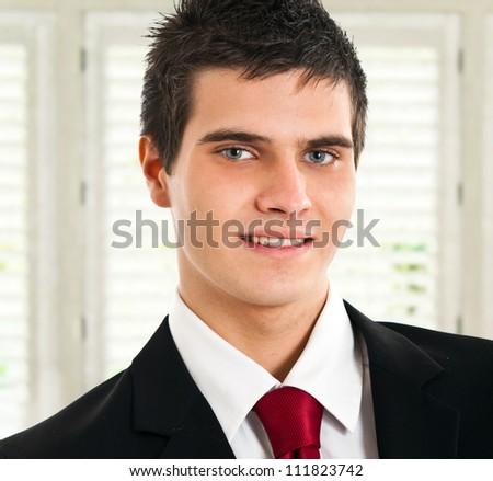 Young successful businessman portrait - stock photo