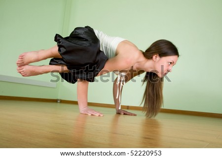 Young woman doing yoga an a floor