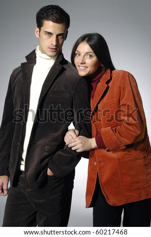. Young woman embraces man. woman in a red dress - stock photo
