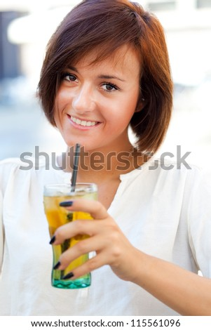 Young woman having a drink outdoor