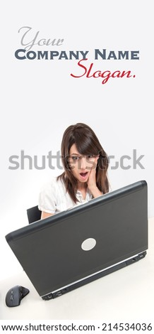 Young woman looking at her desk with her laptop with a surprised expression  - stock photo