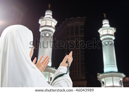 Young woman, muslim pilgrim in white traditional clothes - stock photo