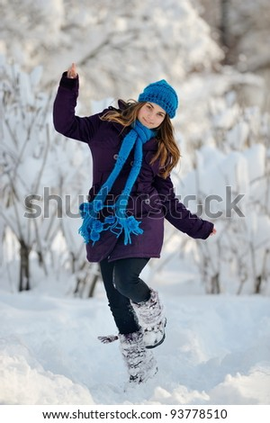 young woman outdoor in winter enjoying the snow - stock photo