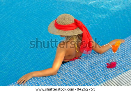 young woman relaxing at the pool - stock photo