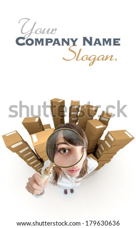 Young woman with a magnifying glass surrounded by piles of cardboard boxes  - stock photo