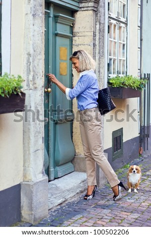 young woman with chihuahua in old city.