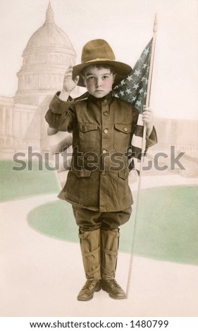 ''Your Country Needs You'' - Little boy in WWI patriotic dress (as an army ''Dough Boy'' soldier), with American flag and U.S. Capitol in background - a circa 1917 vintage photograph - stock photo