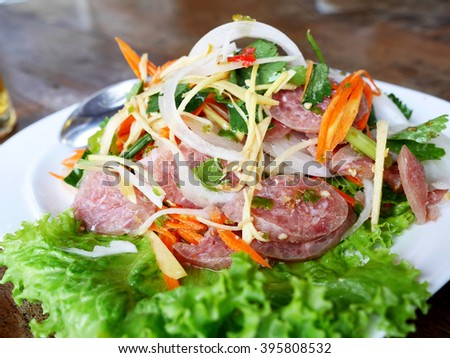 'Yum Nam' Thai Sour Sausage or Thai Fermented Sausage Made With Pork, Pork Skins, Cooked Sticky Rice, Garlic, Salt, Sugar and Chilies. - stock photo