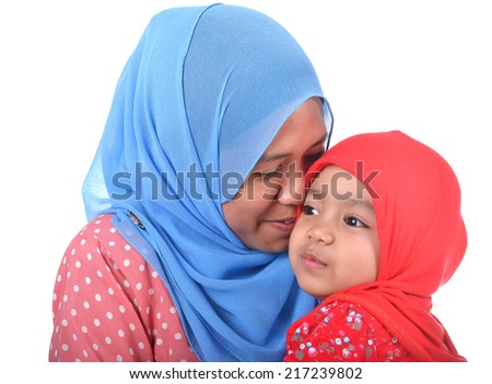 Schoolgirl Saved From Certain Death As Burqa-Clad Woman Pulls Her From Path Of Oncoming Train Stock-photo-Muslim-woman-kissing-her-daughter-love-concept-217239802