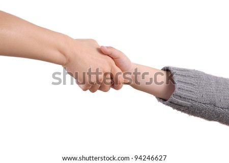 A adult holds child's hand - stock photo