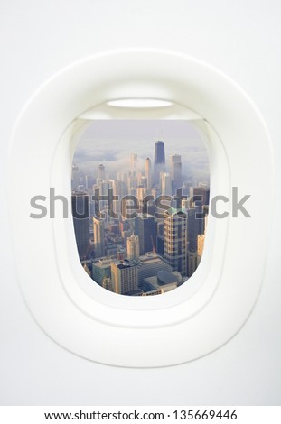 A aerial view of Chicago city skyline from aircraft window on a day with Clouds rolling over Chicago city downtown - stock photo