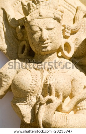 A ancient stone sculpture of a Indian woman - stock photo