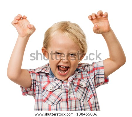 A angry hyperactive young boy yelling. Isolated on white. - stock photo