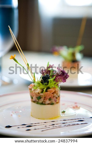 a appetizer meal is served with green vegetable - stock photo