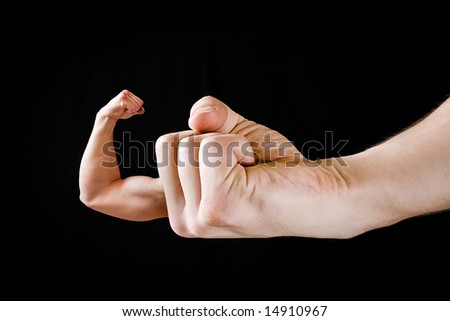 A arm shaped finger showing the concept of working out - stock photo
