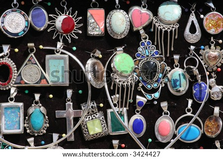 A array of colorful silver pendants at a market