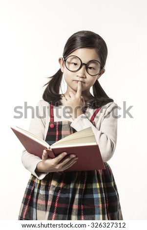 A asian(japan, chinese, korea) pretty girl hold a book and reading, thinking hard, have a questions with a worry isolated white at the studio. - stock photo
