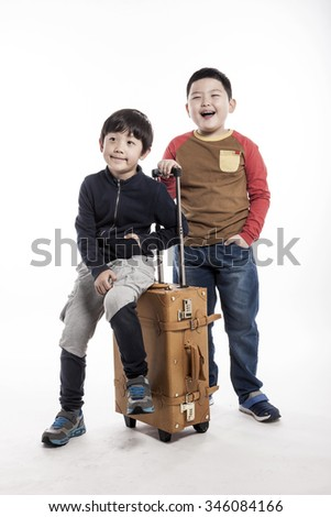 A asian(korean, japanese, chinese) boys(kid, student, child, man, male) sit down and stand up with a luggage(suit case) for tour, journey isolated white. - stock photo