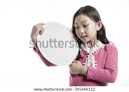 A asian(korean, japanese, chinese) girl(kid, child, woman, female) make a pose wearing pink blouse, skirt with smile and hold a ceramic white empty food tray for kids, baby isolated white.