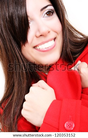A attractive young, latin Adult woman in Winter clothing. Isolated on white.