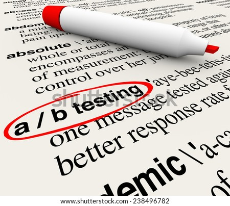 A/B Testing words in a dictionary definition explaining the process or experiment of comparing two messages and seeing which performs better then rolling the highest one to the whole audience - stock photo